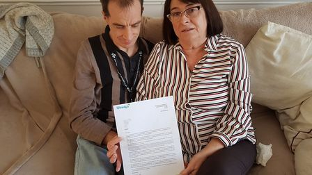 Resident Mark Taylor and his mum Gwen with the letter they received announcing The Dell Care Home in
