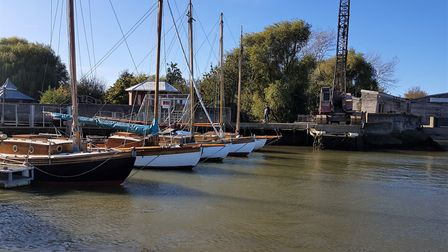 A stunning view of all 5 Deben Cherubs on the water at the Woodbridge Boatyard (Everson's Boatyard).