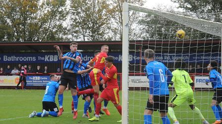 Keiran Morphew rises high to head home and so put Needham Market 2-0 up, against Stourbridge. Pictur