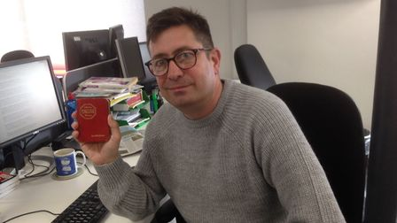 Mark Langford with his pocket dictionary from the 1970s Picture: ARCHANT
