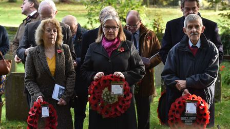 Villagers in Lidgate hold a war memorial rededication service for three men who died in World War Tw