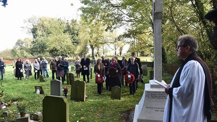 Villagers in Lidgate held a war memorial rededication service for three men who died in World War Tw