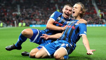 Rochdale teenager Luke Matheson, 16, celebrates his equaliser at Manchester United in the Carabao Cu