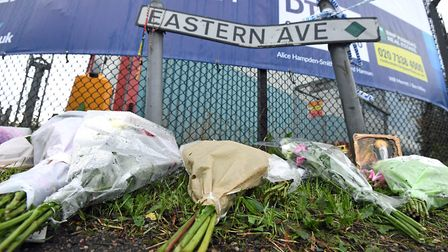 Floral tributes left on Eastern Avenue, Grays, Essex, where 39 bodies were discovered in a lorry Pic