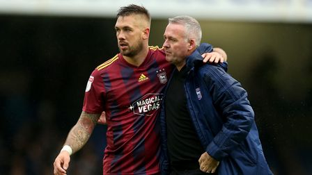Luke Chambers and Paul Lambert hug at the final whistle after the victory over Southend. Picture: PA