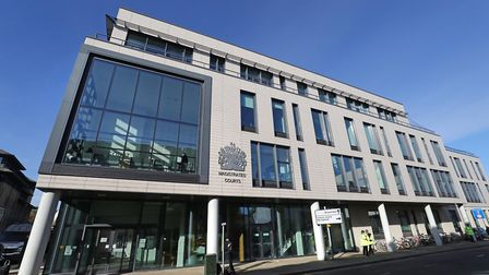 Police outside Chelmsford Magistrates' Court, Essex, where lorry driver Maurice Robinson, 25 appeare