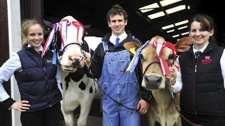 Emma and James Strachan and James' sister Katherine Manning with Champion Holstein and Jersey at t