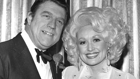 Dolly Parton and David Lowe with his Manager of the year Award November 1978 Photo: Archant