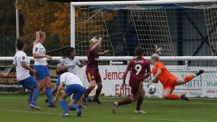 Maddie Biggs scoring the equaliser as Town won 2-1 at Enfield Town Picture: ROSS HALLS