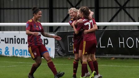 Town players celebrate with Maddie Biggs who equalised for Town in their 2-1 win at Enfield Town Pic