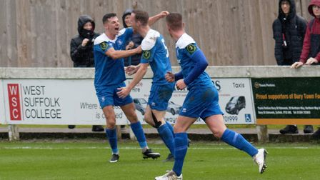 Joe White is congratulated by Ryan Jolland after opening the scoring in Bury Town's 3-1 win over Rom