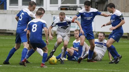 Romford captain Danny Cossington is surrounded by Bury Town players. Picture: PAUL VOLLER