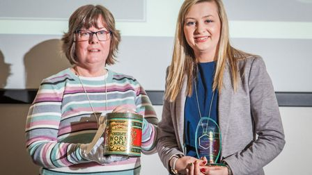 A representative of the Museum of East Anglian Life with their Object of the Year Award and tin of C