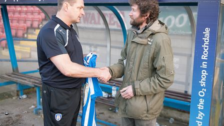 Then-Colchester United manager Tony Humes, left, presents Carl Marston with his commerative U's shir