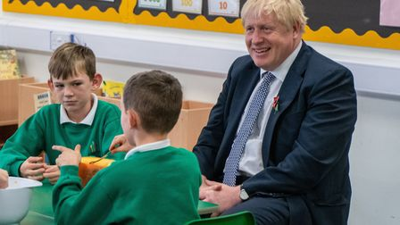 Prime Minister Boris Johnson met puils as they carved pumpkins at Abbots Green Primary Academy in Bu