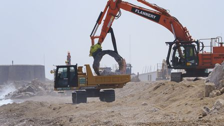 Work is carried out along the sea wall at Slaughden Quay to repair and strengthen the defences Pict