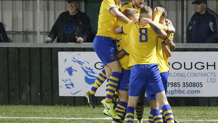 AFC Sudbury players celebrate their last-minute winner, against Canvey Island. Picture: PAUL VOLLER