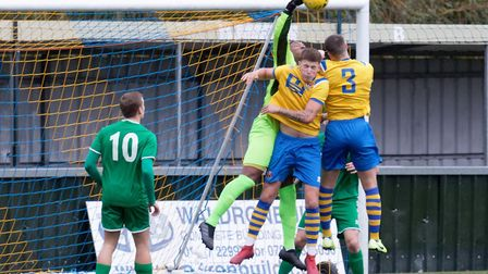 Canvey Island keeper Lamar Johnson punches clear from Sudbury's Baris Altintop and Joe Whight. Pictu