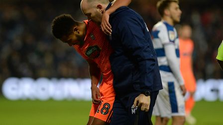 Grant Ward is helped off the pitch in some discomfort at Loftus Road Picture Pagepix