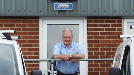 Managing director of Command Pest Control Mark Ward standing underneath Royal Coat of Arms Picture: