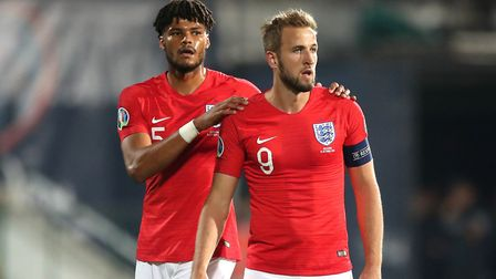 England's Tyrone Mings (left) and Harry Kane (right) during the 6-0 win over Bulgaria. Picture: PA S