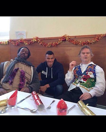 Tyrone Mings feeding the homeless on Christmas Day in 2014.