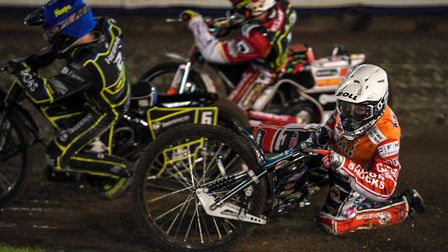 Jason Doyle falls behind Cameron Heeps and Niels-Kristian Iversen on the first bend of the opening h