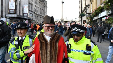 Police remove Eamonn O'Nolan from an Extinction Rebellion climate change protest in London Picture: