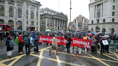 Protesters block the road in front of the Bank of England in the City of London, during an Extinctio