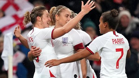 England's Ellen White (left) celebrates scoring her side's first goal with team-mates during the Wom