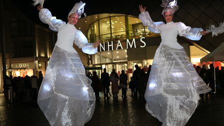 Ladies on stilts at the Bury christmas light switch on Picture: CHARLOTTE BOND