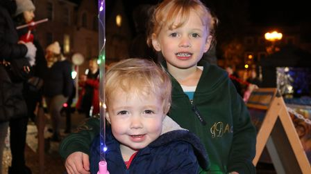 Sisters Constance and Clemency enjoying the light switch on Picture: CHARLOTTE BOND