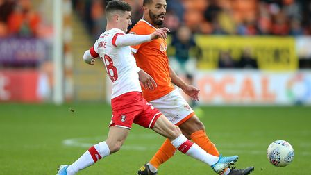 Blackpool's Liam Feeney (right) had a loan spell at Ipswich Town. Photo: PA