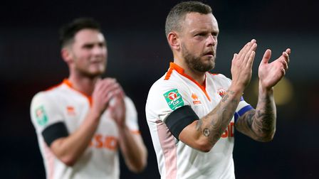 Blackpool skipper Jay Spearing applauds the fans. Photo: PA