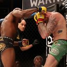 Referee Rich Mitchell steps in to stop the middleweight title fight at Cage Warriors 111, with Nathi