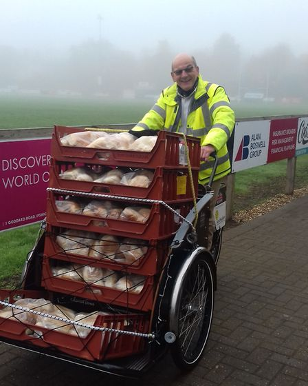 Volunteer rider David Fisher collecting food from the Rugby Club for Bury Drop In Picture: BURY RIC