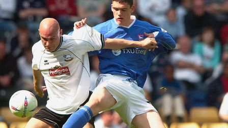 Aidan Collins challenges Derby's Steve Stone during his Ipswich Town debut in 2003. Picture ARCHANT