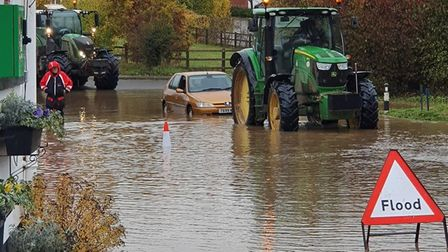 A car stuck in the road near The Parrot at Aldringham after the road was badly flooded Picture: CHR