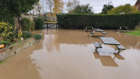 The beer garden at The Parrot at Aldringham is badly flooded Picture: CHRIS THEOBALD