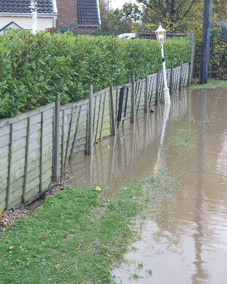 Damage to the fence at The Parrot at Aldringham after the area was flooded Picture: CHRIS THEOBALD