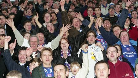 Happy days: Ipswich Town Town fans in good spirits during their side's 1-0 win at Stockport County i