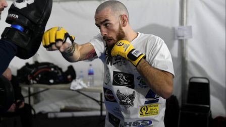 Scott Butters warming up before Cage Warriors 111. He has announced his retirement after losing to K