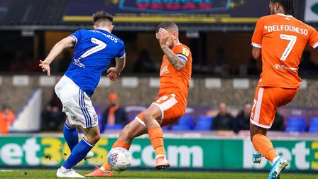 Gwion Edwards shoots but the ball is blocked by Blackpool skipper Jay Spearing.Picture: Steve Wal
