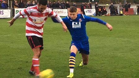 AFC left-back Baris Altintop is quick to close down Kingstonian winger Dan Bennett, during Saturday'