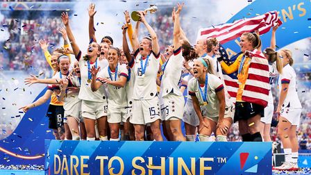 USA's Megan Rapinoe (centre) and team-mates celebrate with the FIFA Women's World Cup Trophy Picture
