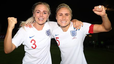 England Women's Steph Houghton (right) and Alex Greenwood celebrate victory after aWomen's World Cup