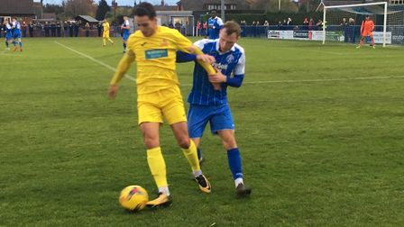 Leiston right-back Kyle Hammond keeps an eye on a Banbury opponent during this afternoon's Southern