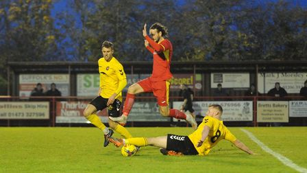 Joe Marsden is stopped in his tracks by a Rushall defender Photo; BEN POOLEY
