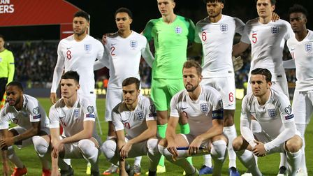 Former Bury Town player Nick Pope faces the camera with the England team on his full international d