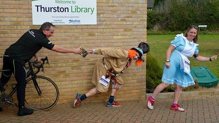 Alice and the Mad Hatter getting ready to run the book. Picture: SUFFOLK LIBRARIES